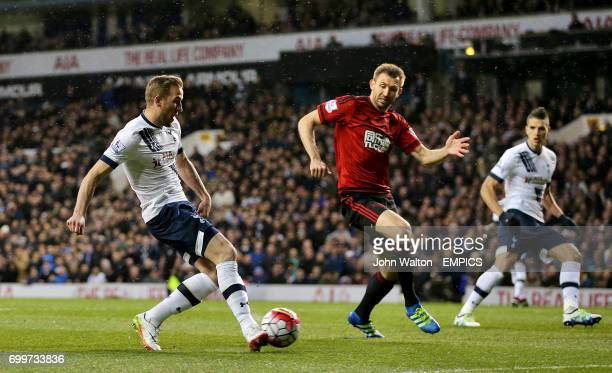 Tottenham Hotspur's Harry Kane has a shot on goal under pressure from West Bromwich Albion's Gareth McAuley