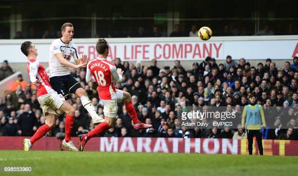 Tottenham Hotspur's Harry Kane in action with Arsenal's Laurent Koscielny and Nacho Monreal