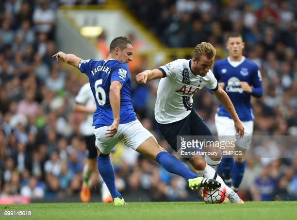 Tottenham Hotspur's Harry Kane is tackled by Everton's Phil Jagielka
