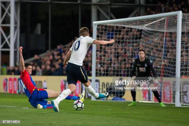 Tottenham Hotspur's Harry Kane sees his shot blocked by Crystal Palace's Martin Kelly during the Premier League match between Crystal Palace and...