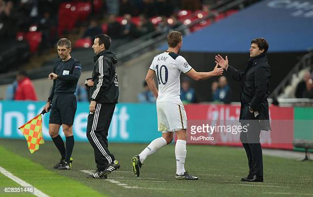 Tottenham Hotspur's Harry Kane shanks hands with Tottenham Hotspur manager Mauricio Pochettino during UEFA Champions League Group E match between...