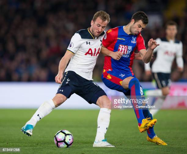 Tottenham Hotspur's Harry Kane under pressure from Crystal Palace's Luka Milivojevic during the Premier League match between Crystal Palace and...