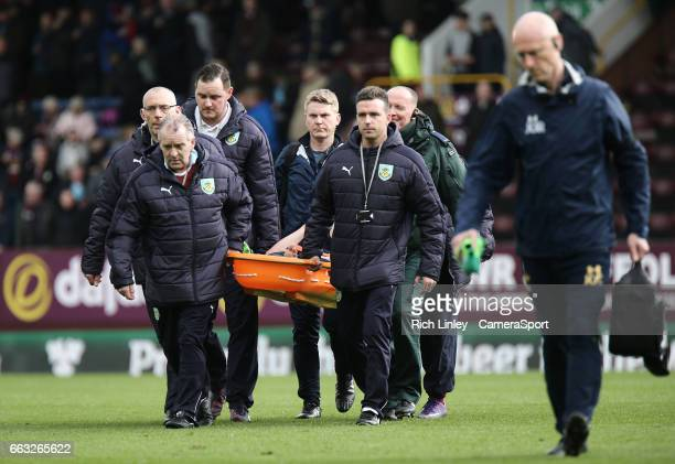 Tottenham Hotspur's Harry Winks is stretchered off at half time during the Premier League match between Burnley and Tottenham Hotspur at Turf Moor on...