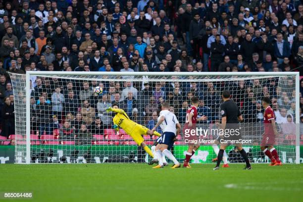 Tottenham Hotspur's Hugo Lloris saves from the shot of Liverpool's Philippe Coutinho during the Premier League match between Tottenham Hotspur and...