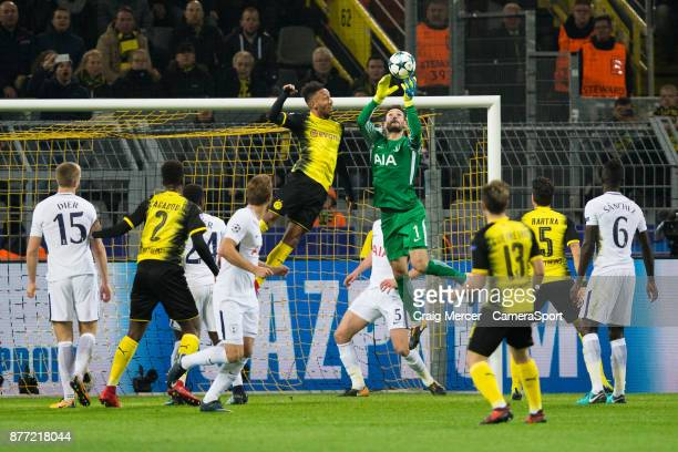 Tottenham Hotspur's Hugo Lloris saves under pressure from Borussia Dortmund's PierreEmerick Aubameyang during the UEFA Champions League group H match...