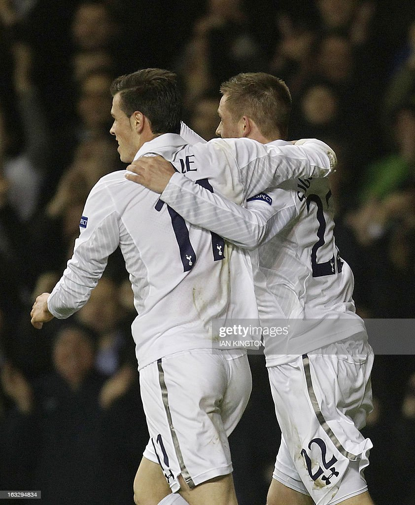 Tottenham Hotspur's Icelandic midfielder Gylfi Sigurdsson (R) celebrates his goal with team-mate Gareth Bale during a UEFA Europa League Round of 16 football match between Tottenham Hotspur and Inter Milan at White Hart Lane in east London, on March 7, 2013.
