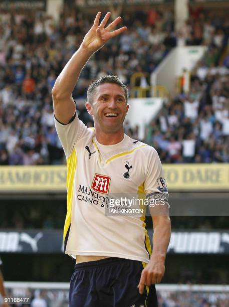 Tottenham Hotspur's Irish player Robbie Keane celebrates after scoring his fourth goal during the English Premier League football match between...