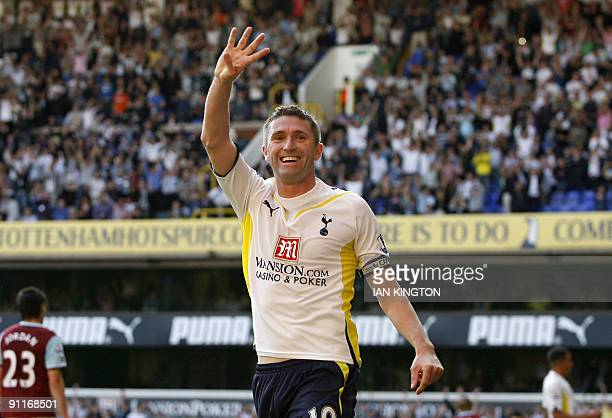 Tottenham Hotspur's Irish player Robbie Keane celebrates scoring his fourth goal during the English Premier League football match between Tottenham...