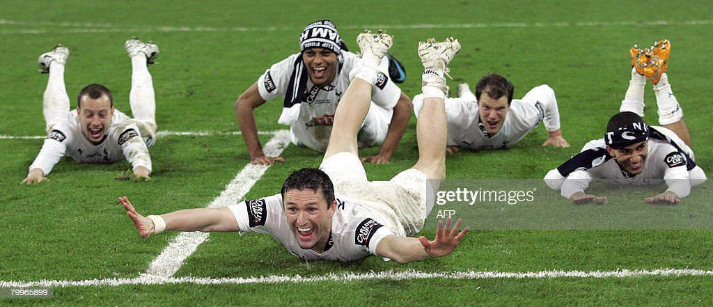 Tottenham Hotspurs' Irish striker Robbie Keane celebrates with his teammates after winning the Carling Cup Final match against Chelsea at Wembley...