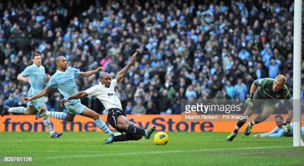Tottenham Hotspur's Jermain Defoe misses a great chance to score as Manchester City's Gael Clichy and Joe Hart dive to block his shot during the...