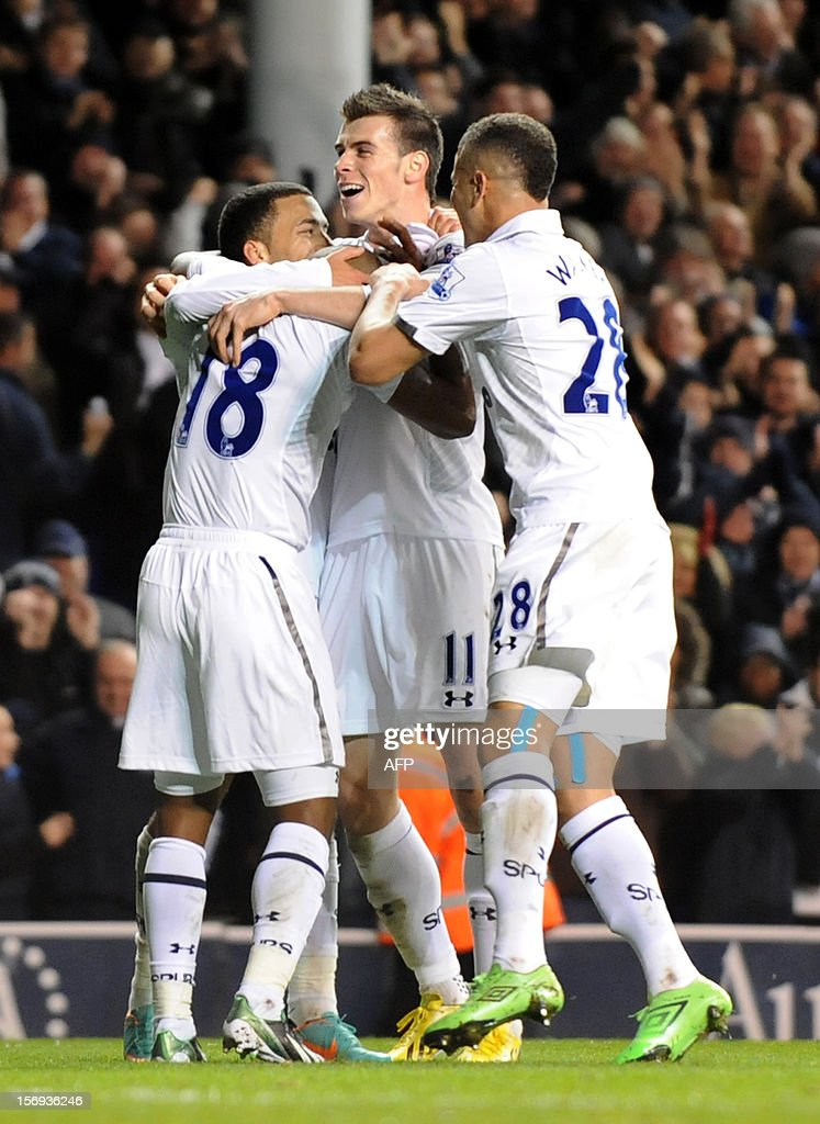 """Tottenham Hotspur's Jermaine Defoe (C) celebrates scoring his 2nd goal with his teammates against West Ham during their English Premier League football match at White Hart Lane in North London, England, on 25 November, 2012. Tottenham Hotspur won the match 3-1. AFP PHOTO/OLLY GREENWOOD USE. No use with unauthorized audio, video, data, fixture lists, club/league logos or """"live"""" services. Online in-match use limited to 45 images, no video emulation. No use in betting, games or single club/league/player publications."""