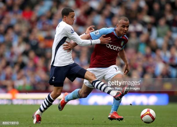 Tottenham Hotspur's Jermaine Jenas and Aston Villa's Gabriel Agbonlahor battle for the ball