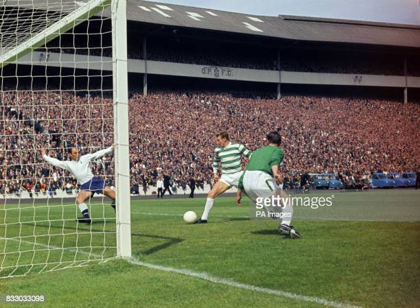 Tottenham Hotspurs Jimmy Greaves beats Celtic goalkeeper Ronnie Simpson to score the first goal for Spurs in the preseason challenge match at Hampden...