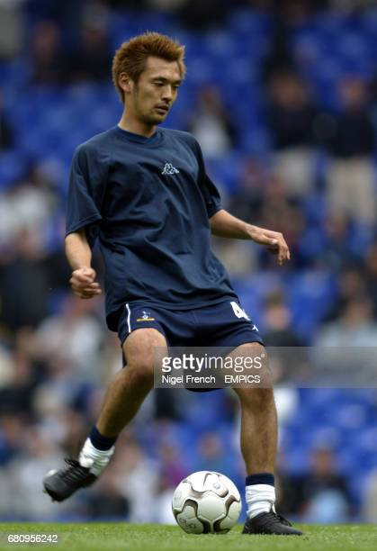 Tottenham Hotspur's Kazuyuki Toda warms ups before the game against Manchester United