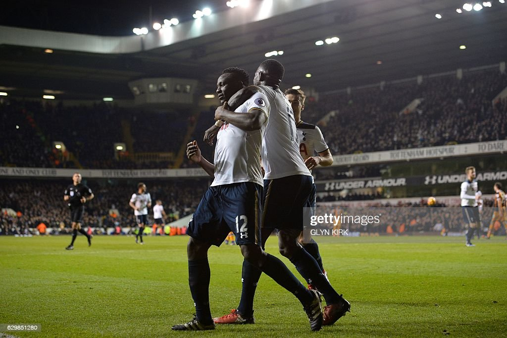 Tottenham Hotspur's Kenyan midfielder Victor Wanyama (L) celebrates scoring his team's third goal with Tottenham Hotspur's French midfielder Moussa Sissoko during the English Premier League football match between Tottenham Hotspur and Hull City at White Hart Lane in London, on December 14, 2016. / AFP / Glyn KIRK / RESTRICTED TO EDITORIAL USE. No use with unauthorized audio, video, data, fixture lists, club/league logos or 'live' services. Online in-match use limited to 75 images, no video emulation. No use in betting, games or single club/league/player publications. /