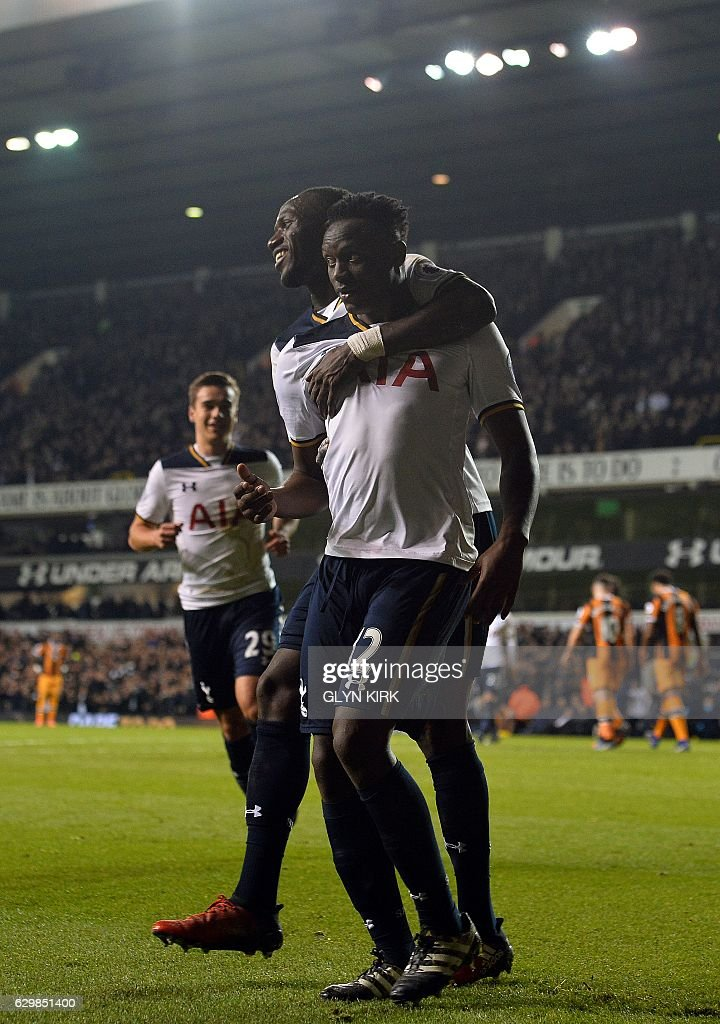 Tottenham Hotspur's Kenyan midfielder Victor Wanyama (R) celebrates scoring his team's third goal with Tottenham Hotspur's French midfielder Moussa Sissoko during the English Premier League football match between Tottenham Hotspur and Hull City at White Hart Lane in London, on December 14, 2016. / AFP / Glyn KIRK / RESTRICTED TO EDITORIAL USE. No use with unauthorized audio, video, data, fixture lists, club/league logos or 'live' services. Online in-match use limited to 75 images, no video emulation. No use in betting, games or single club/league/player publications. /