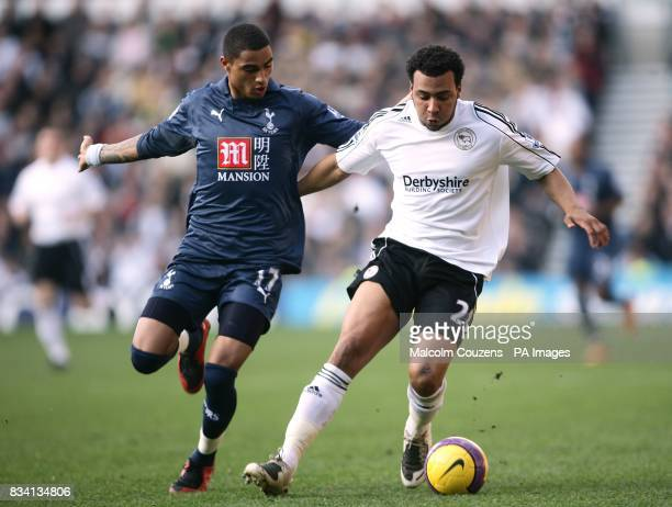 Tottenham Hotspur's KevinPrince Boateng and Derby County's Giles Barnes battle for the ball