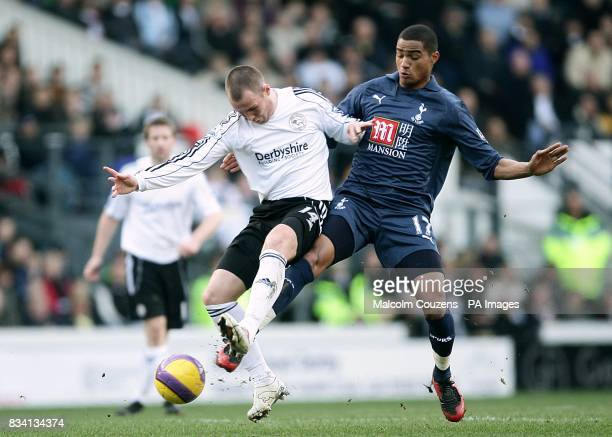 Tottenham Hotspur's KevinPrince Boateng and Derby County's Kenny Miller battle for the ball