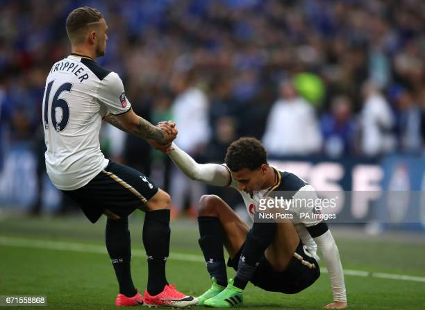Tottenham Hotspur's Kieran Trippier helps Tottenham Hotspur's Dele Alli up from the floor after the final whistle during the Emirates FA Cup Semi...