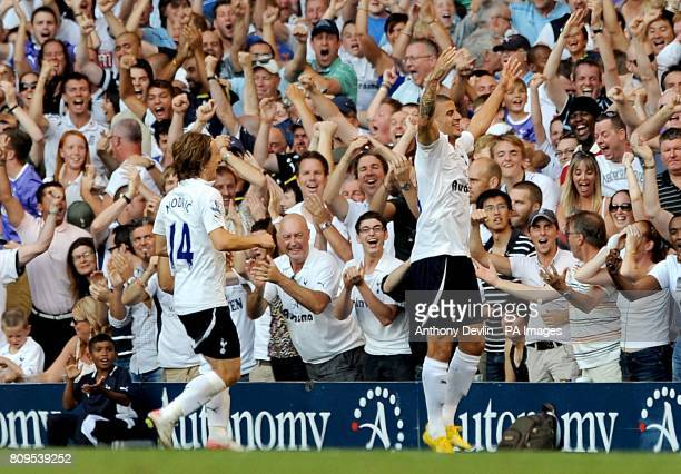 Tottenham Hotspur's Kyle Walker celebrates with team mate Luka Modric after scoring his side's winning goal