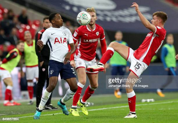 Tottenham Hotspur's Kyle WalkerPeters and Barnsley's Harvey Barnes battle for the ball during the Carabao Cup third round match at Wembley Stadium...