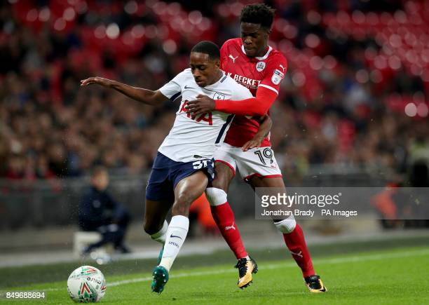 Tottenham Hotspur's Kyle WalkerPeters and Barnsley's Ike Ugbo battle for the ball during the Carabao Cup third round match at Wembley Stadium London