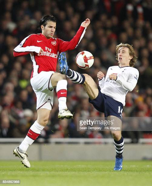Tottenham Hotspur's Luka Modric and Arsenal Cesc Fabregas battle for the ball