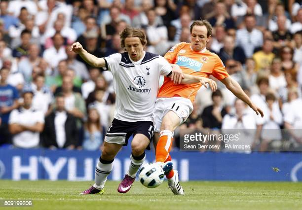 Tottenham Hotspur's Luka Modric and Blackpool's David Vaughan in action
