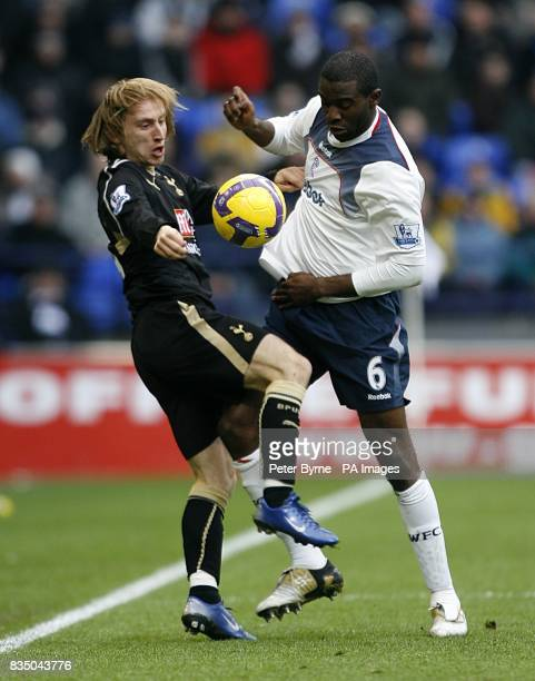 Tottenham Hotspur's Luka Modric and Bolton Wanderers' Fabrice Muamba battle for the ball