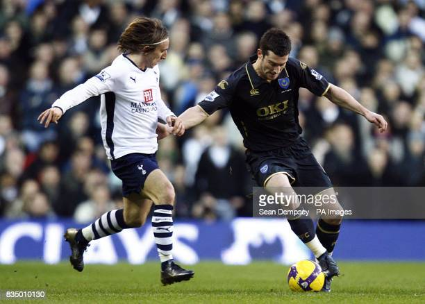 Tottenham Hotspur's Luka Modric and Portsmouth's David Nugent battle for the ball