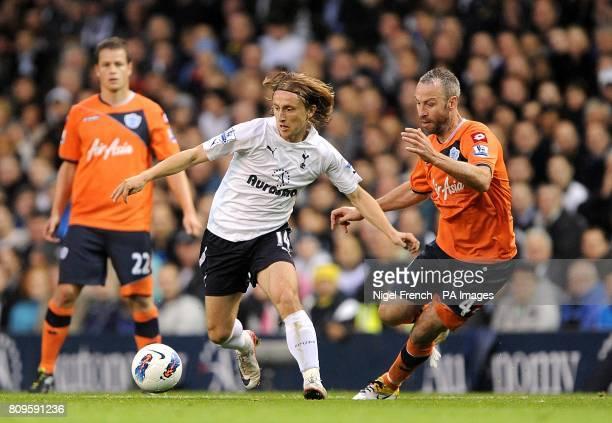 Tottenham Hotspur's Luka Modric and Queens Park Rangers' Shaun Derry battle for the ball