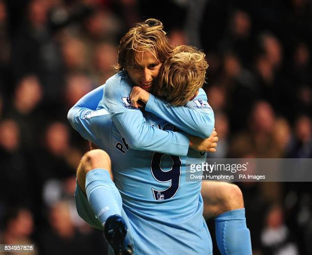 Tottenham Hotspur's Luka Modric celebrates scoring his sides first goal of the game with teammate Roman Pavlyuchenko