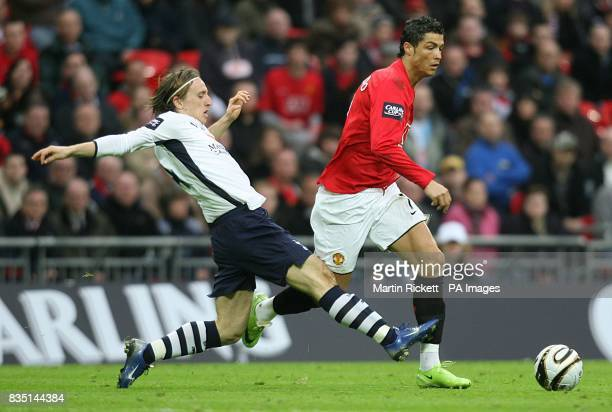 Tottenham Hotspur's Luka Modric challenges Manchester United's Cristano Ronaldo for the ball