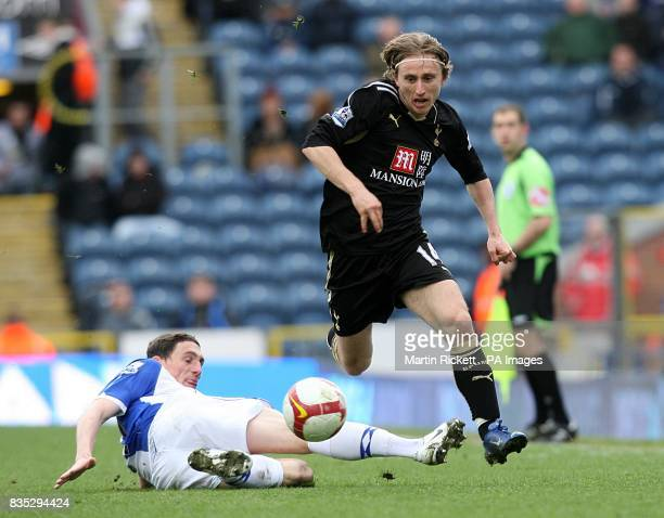 Tottenham Hotspur's Luka Modric jumps clear of a challenge from Blackburn Rovers' Keith Andrews