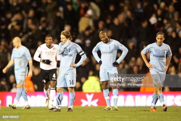Tottenham Hotspur's Luka Modric William Gallas and Steven Pienaar appear dejected