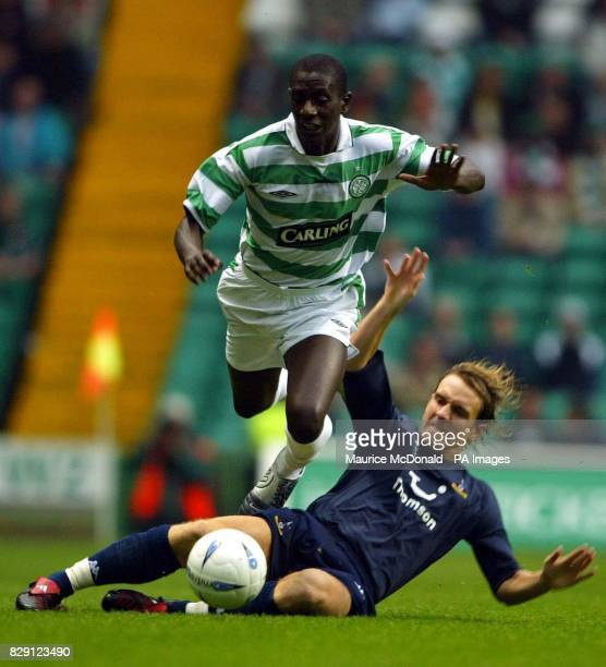 Tottenham Hotspur's Mark Hughes attempts to get the ball away from Celtic's Momo Sylla during their preseason friendly match at Hampden Park Glasgow...