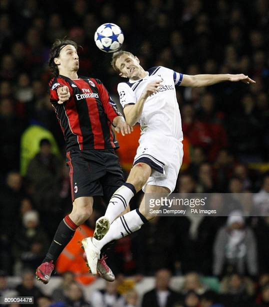 Tottenham Hotspur's Michael Dawson and AC Milan's Zlatan Ibrahimovic battle for the ball in the air