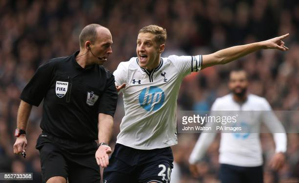 Tottenham Hotspur's Michael Dawson remonstrates as referee Mike Dean gives a penalty