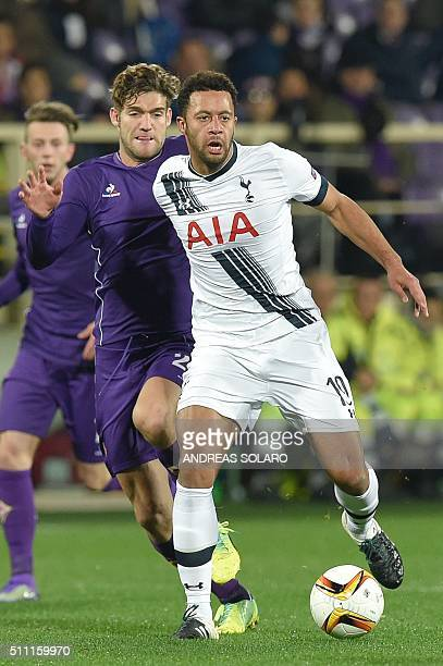 Tottenham Hotspurs midfielder from Belgium Mousa Dembele fights for the ball with Fiorentina's defender from Spain Marcos Alonso Mendoza during the...