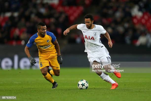 Tottenham Hotspur's Mousa Dembele and APOEL Nicosia's Lorenzo Ebecilio during the UEFA Champions League group H match between Tottenham Hotspur and...