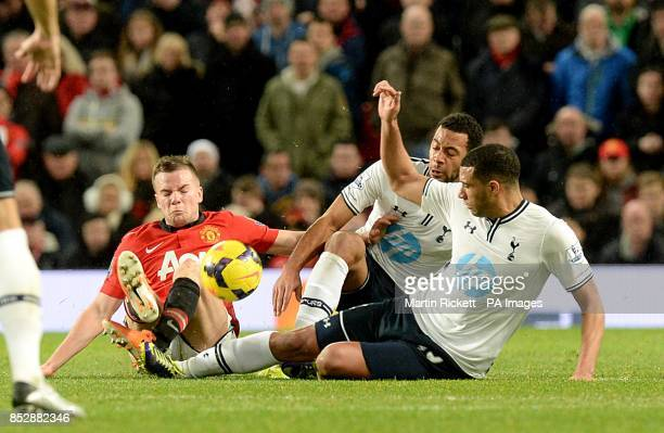 Tottenham Hotspur's Mousa Dembele and Etienne Capoue battle for the ball with Manchester United's Tom Cleverley