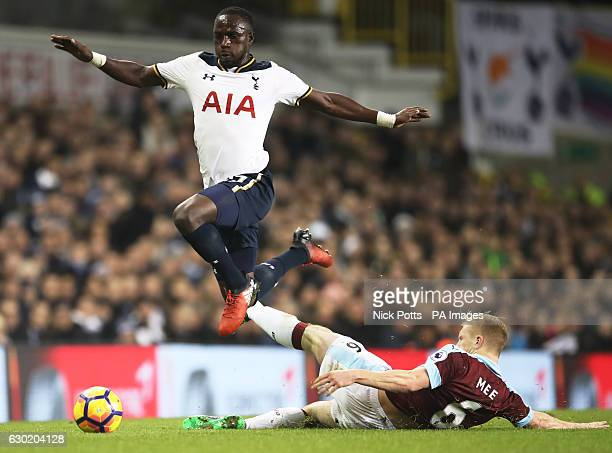 Tottenham Hotspur's Moussa Sissoko hurdles a tackle from Burnley's Ben Mee during the Premier League match at White Hart Lane London