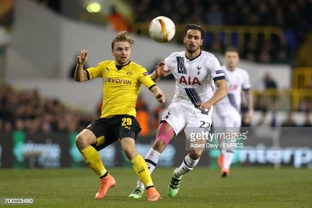 Tottenham Hotspur's Nacer Chadli and Dortmund's Marcel Schmelzer battle for the ball