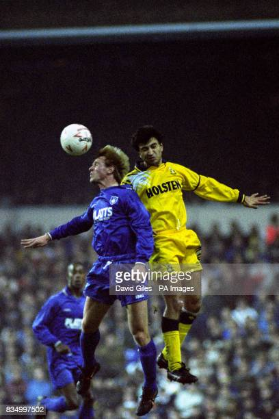 Tottenham Hotspur's Nayim battles for the ball with a Marlow player