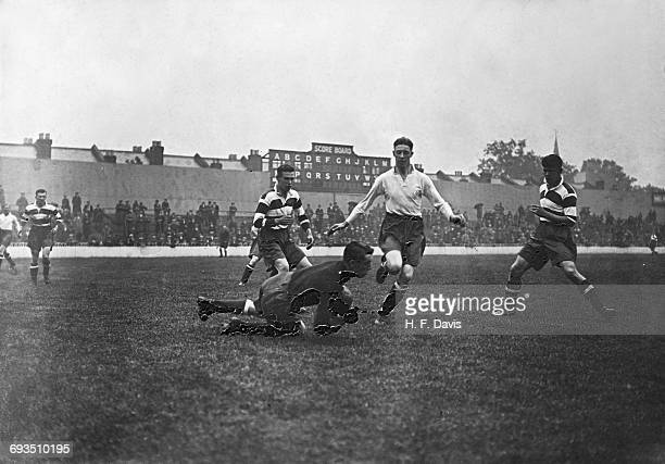 Tottenham Hotspur's new goalkeeper Joe Nicholls making a save from Taffy O'Callaghan during the team's first public practice match at Spurs' White...