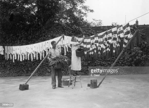 Tottenham Hotspur's own laundress hangs out the players' shirts and shorts before the start of the new season