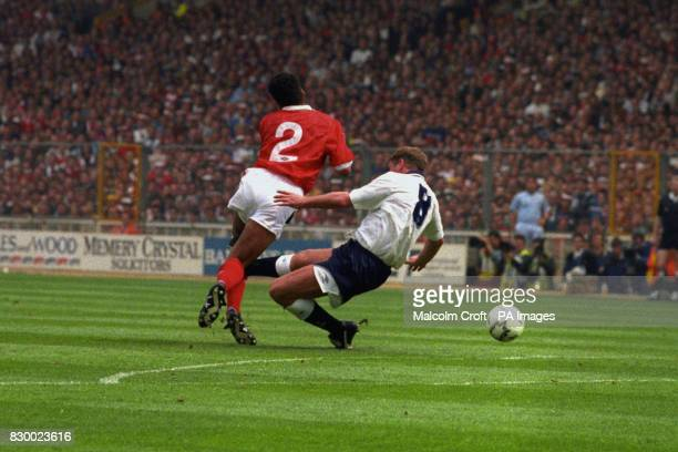 Tottenham Hotspur's Paul Gascoigne lunges in on Nottingham Forest's Gary Charles only to rupture his own knee ligaments and be out the game for over...