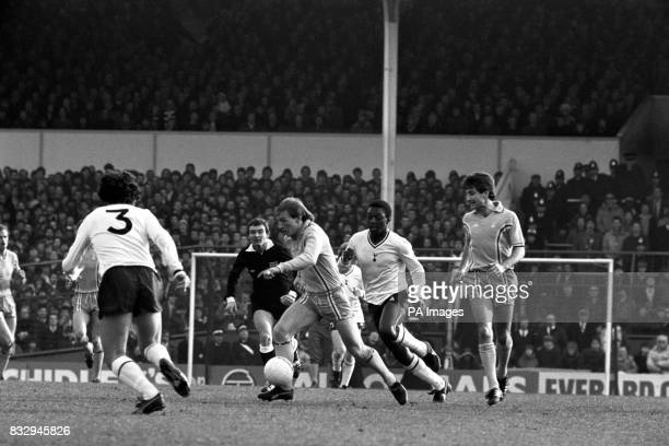 Tottenham Hotspur's Paul Miller and Garth Crooks close in on Coventry City's Steve Hunt as referee Joseph Worrall looks on