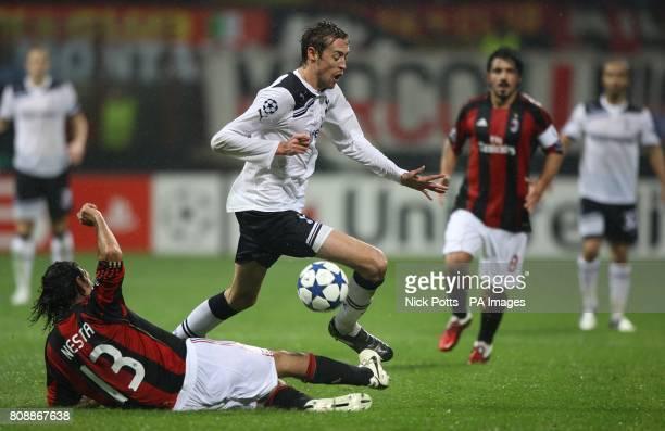 Tottenham Hotspur's Peter Crouch is challenged AC Milan's Alessandro Nesta
