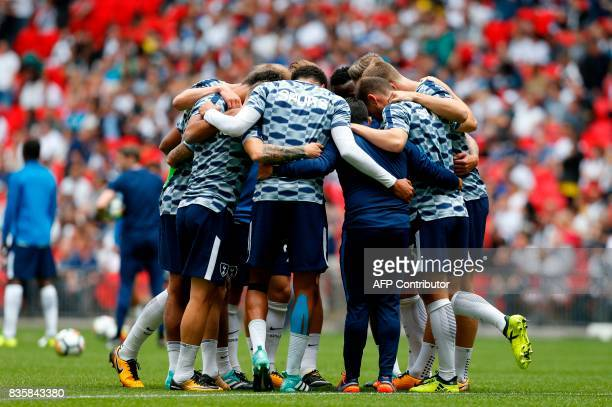 Tottenham Hotspur's players huddle during the warm up ahead of the English Premier League football match between Tottenham Hotspur and Chelsea at...